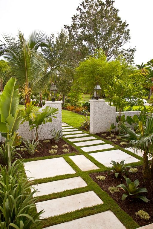 Tropical Landscape/Yard with Pathway, exterior stone floors, Cold Hardy Banana Tree, Oversize concrete pavers, Fence