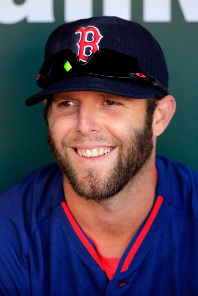 Dustin Pedroia #15 of the Boston Red Sox sits in the dugout before the start of the Red Sox game against the Baltimore Orioles at Oriole Par...