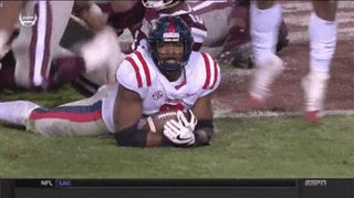 cool Ole Miss football player waves to the camera after fumble recovery : gifs