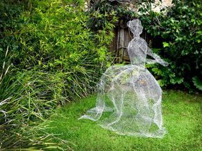Make a life sized ghost using chicken wire. The wire gives the ghost a barely there feel, and will sit sturdily on a lawn. Happy haunting!
