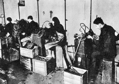 Jews are forced to work in terrible conditions in a metal shop in the ghetto.
