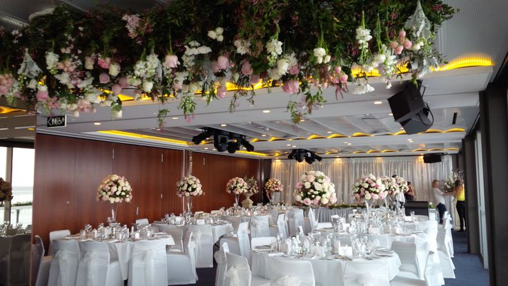 Emilie's #beautiful #wedding @Merewether Surf House #floral #centrepieces #floral #chandelier