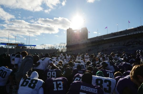 Michigan State Spartans and Northwestern Wildcats players gather at the center of the field after the game at Ryan Field. Michigan State won 30-6. Mandatory Credit: Reid Compton-USA TODAY Sports
