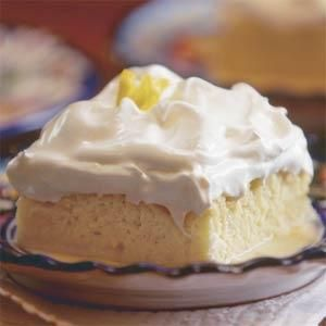 This exceptional dessert takes a little extra effort, but it's worth it. The combination of textures–tender cake, fluffy frosting, and a pool of creamy sauce–will delight your family and friends. If you don't have a double boiler to make the frosting, place a metal mixing bowl over a saucepan instead.