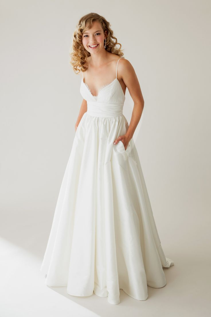 A daring neckline open back and spaghetti straps add for Adding straps to wedding dress