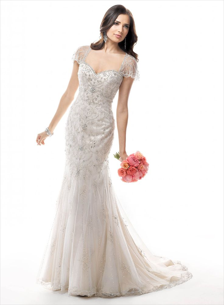 And glamour come together in this gorgeous beaded slim a line gown