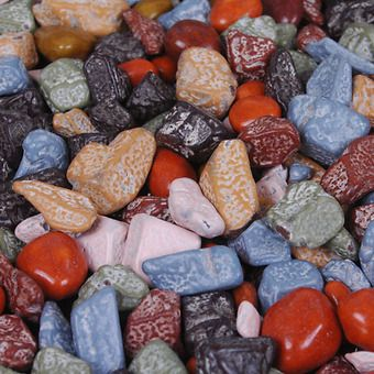Chocolate Rocks -- These classic milk chocolate multi-colored chocolate rocks are an amazing favor for any event. Designed to look like small river rocks but are actually chocolate!