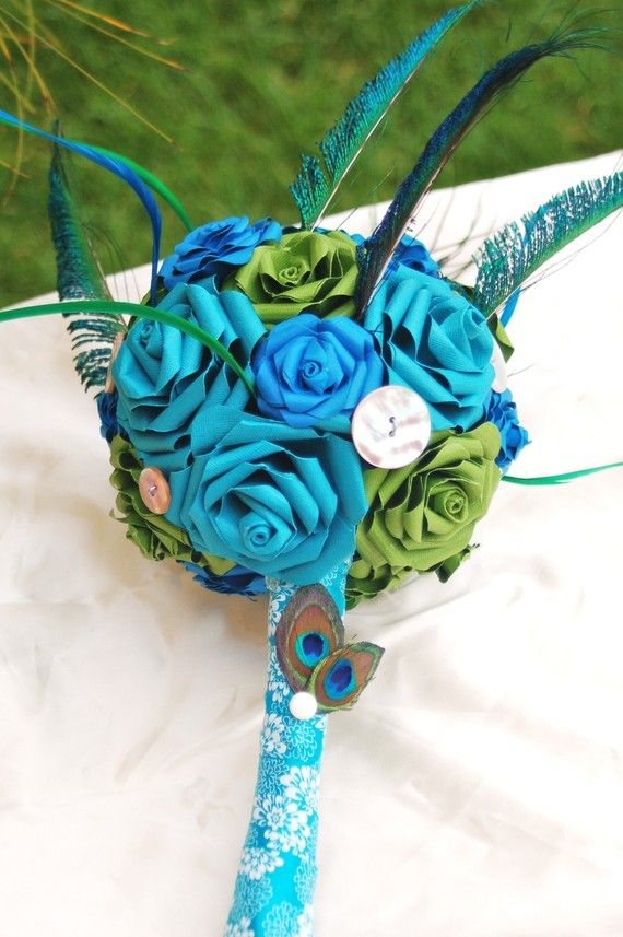 paper flower wedding bouquet...cant wait to try to make it. I'm a scrapbooker and enjoy paper crafts...adds a personal touch to the wedding.