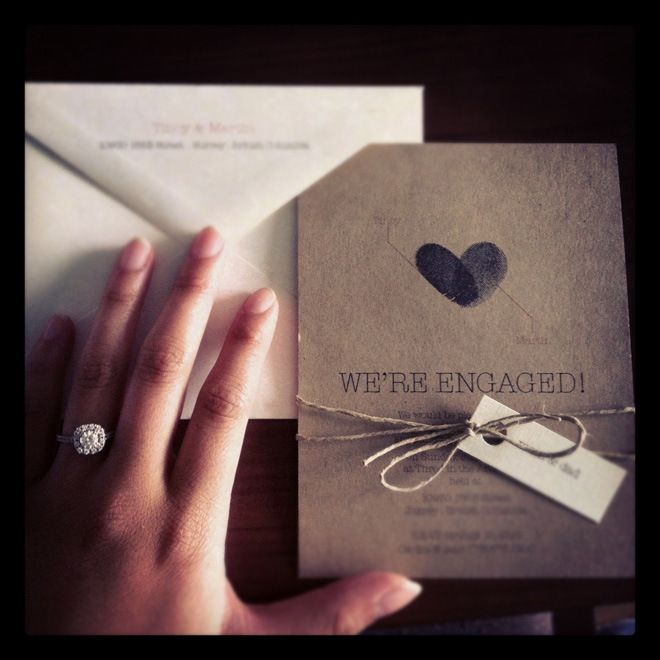Can do on different paper.  One thumb print red the other black perhaps?  Thumbprint Engagement Invites, gives me an idea!