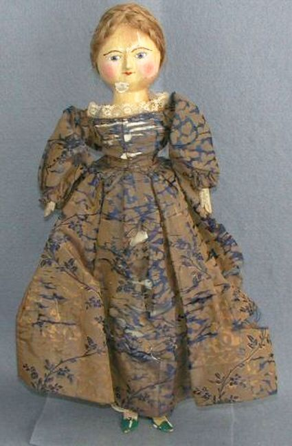 Wooden doll, woman, blue and gold tapestry dress, England, 1755-1810.