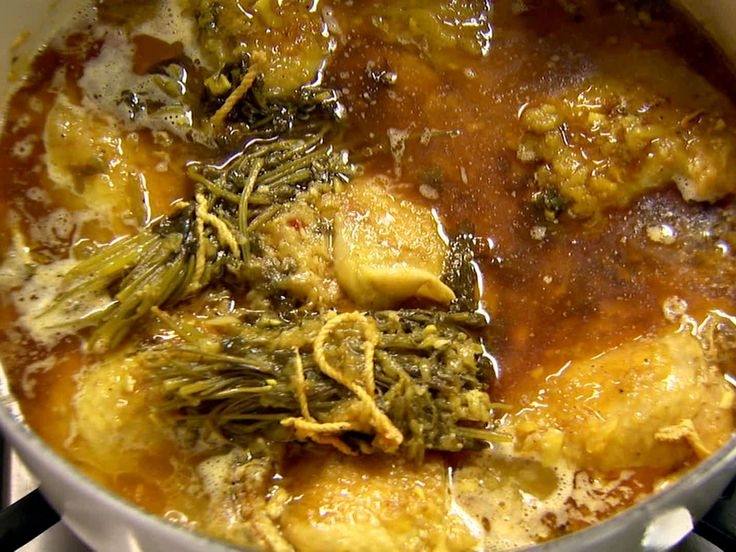 Get this all-star, easy-to-follow Food Network Moroccan Chicken Tajine recipe from Ina Garten.