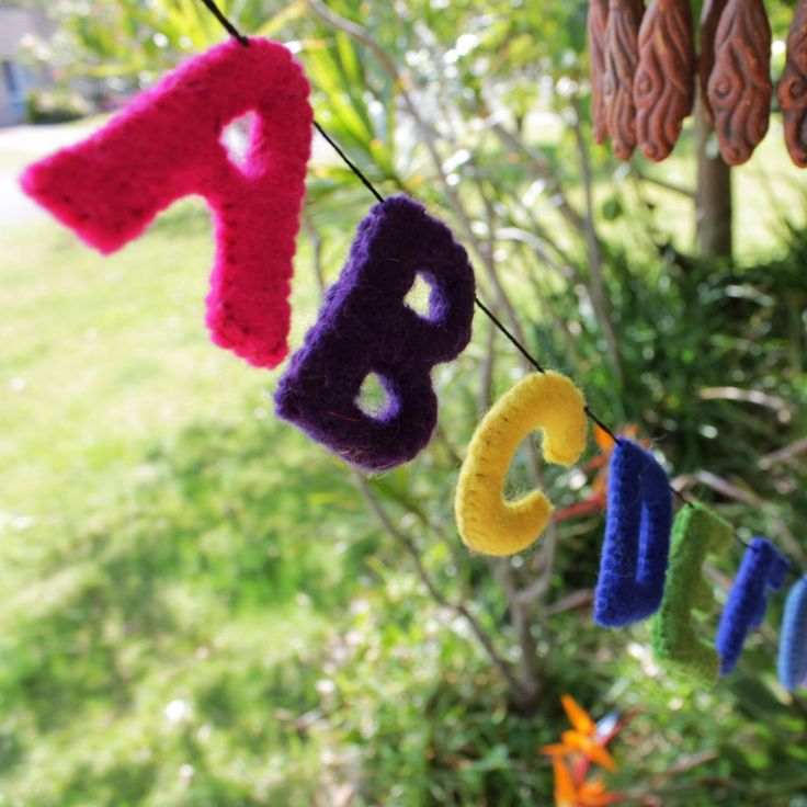 Full 26 letter alphabet buntingComes ready to hang - loops on both endsEducational toyEntirely handmade productEthically crafted in NepalMake learning fun with our fell alphabet bunting strings. Sold ready to hang with sturdy loops on both ends, our alphabet bunting simply hangs over hooks, curtain rods or on a mantle.FIBRE: 100% felted WOOL (from Australia