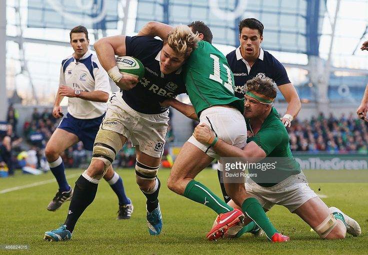 David Denton of Scotland is tackled short of the try line during the RBS Six Nations match...