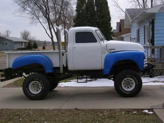 vintage blue and white Chevrolet truck