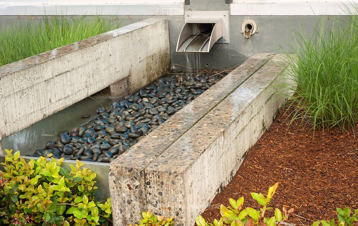 Effective stormwater management in a dense urban area.  Swales and stormwater planters collect stormwater from roof downspouts, parking lot and street.  Appropriate vegetation filters out pollutants in the stormwater before it soaks into the ground, naturally recharging groundwater.  RiverEast Center Stormwater Management facility - a public-private stormwater management partnership (PPP) in Portland, Oregon.