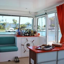 The owner has made amazing use of the limited space on this fabulous Holiday Houseboat filled with retro decor.