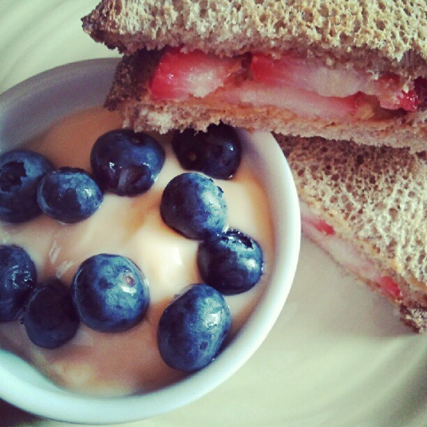 ... on whole grain toast with peach yogurt and fresh blueberries