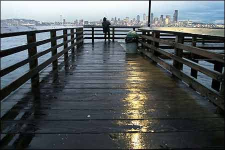 Propose in the rain someplace pretty and get rob to take photos from the condo…