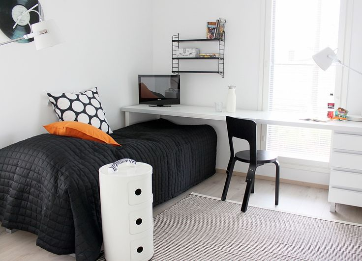 Clever! Long desk surface runs over foot of bed, saving space.