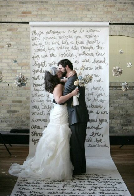 Hand-painted script ceremony backdrop  DIY wedding craft idea. think this would be a neat idea for photo booth back drop w maybe first song lyrics, inside jokes, even have a friend paint on your own written vowels and you can't see it til the day of.