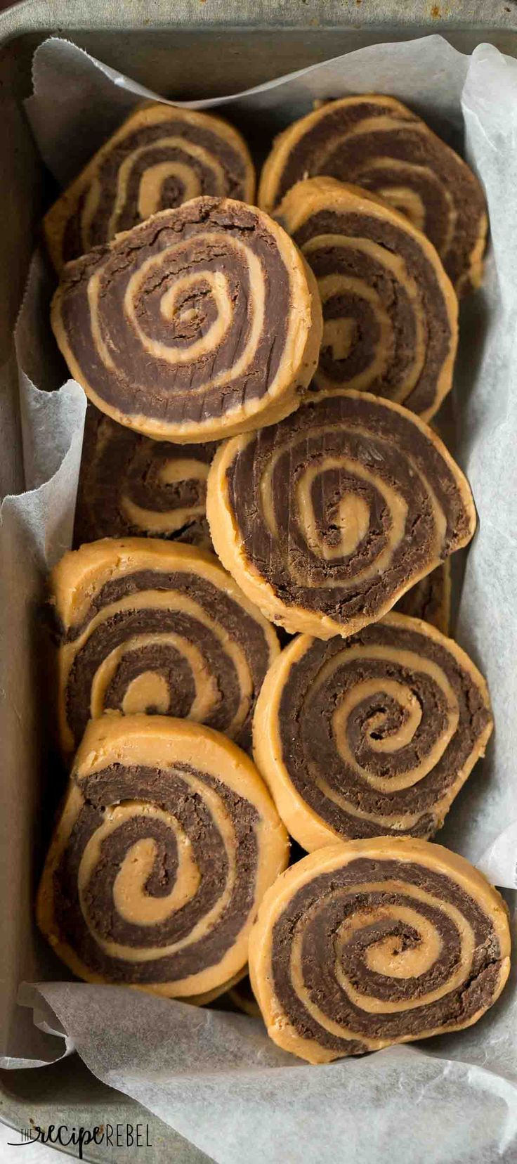 These no bake Chocolate Peanut Butter Pinwheels are easy with only 3 ingredients! They are made up of two layers of fudge, rolled together into a pinwheel shape!