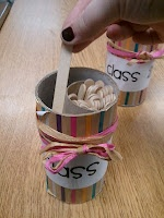 A twist on name popsicle sticks in a can - put a toilet paper roll inside to put those already chosen to the side.
