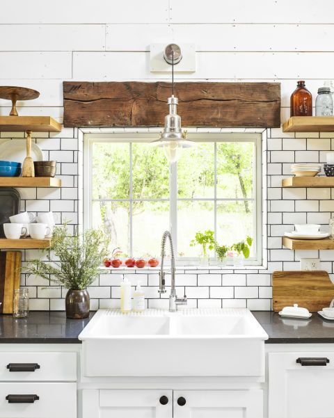 LOVE everything about this kitchen! Wood open shelving, black counter tops, farmhouse sink, distressed wood...perfection <3
