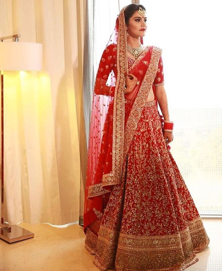 Red Bridal Outfit With Intricate Golden Embroidery