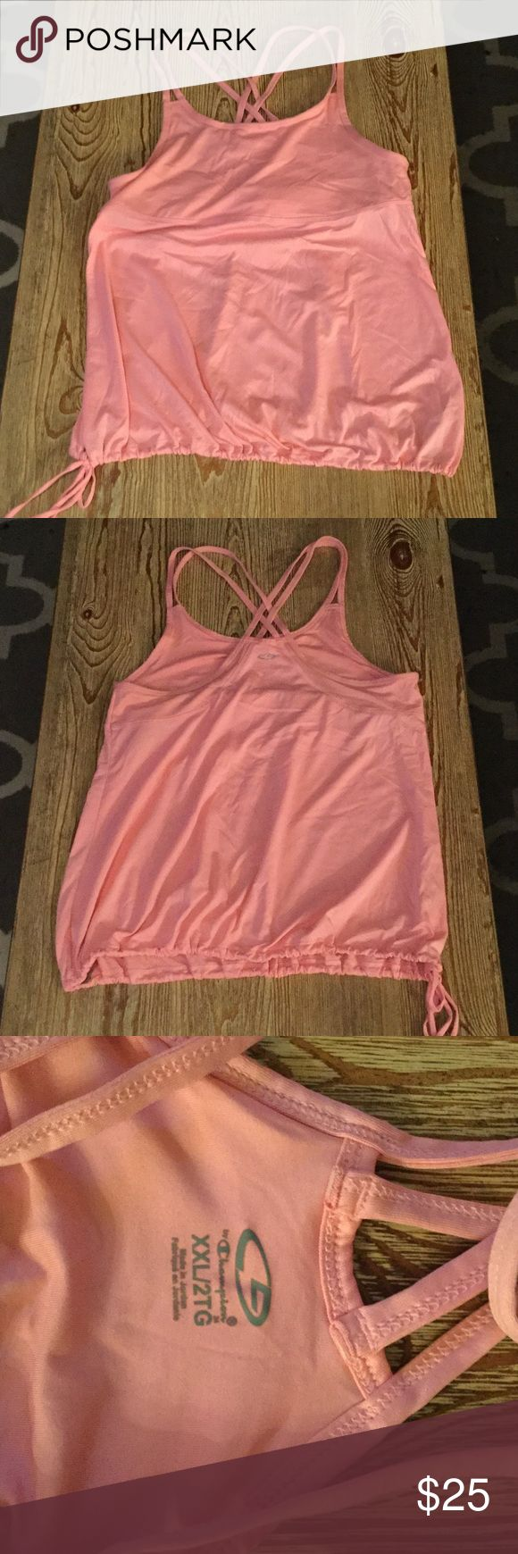 Champion pink cute workout shirt Champion pink workout strappy razorback workout shirt. Tight built-in bra and loose fit bottom half of shirt with adjustable tie. Champion Tops Tank Tops