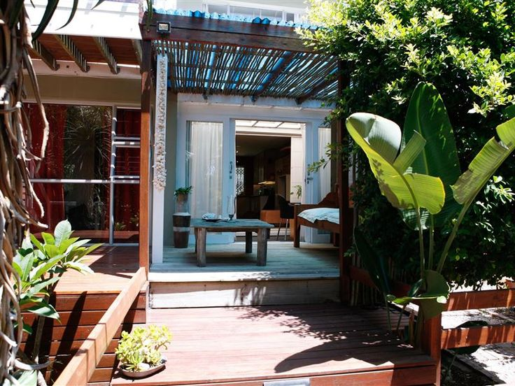 Typhoon Terrace - There are lots of fun modern touches to create a simple and relaxed atmosphere. The apartment is very big and has a spa-bath and private covered deck surrounded by a peaceful garden. The kitchen has everything ... #weekendgetaways #plettenbergbay #gardenroute #southafrica