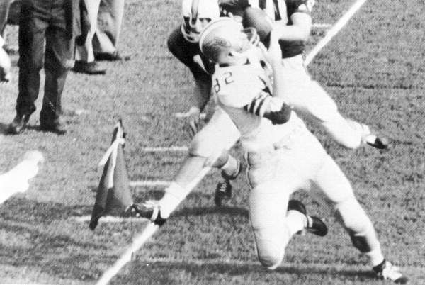 Lane Fenner catching what should have been the winning TD in the UF-FSU game, but the umpire called him out, allowing UF to win. The photographer gave this out, proving FSU won (1966). | Florida Memory