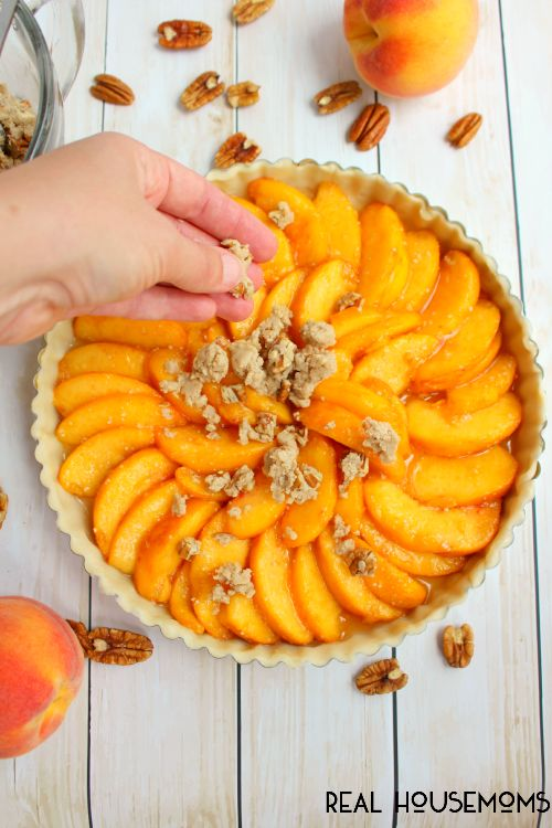 Our Peach Crumble Tart is ike peach pie, but better!! This will be your new favorite way to enjoy summer's best peaches!