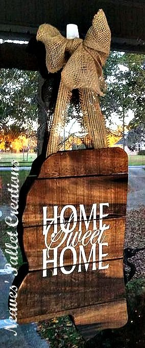 "RECYCLED WOOD PALLETS: This was a custom ordered Door Hanger. It is the outline of the state of Mississippi, stained with a hand painted ""Home Sweet Home"" in the middle of it. It has a Burlap bow and hanger. It is 11"" x 17"" and has total hanging length of 27"". We are selling this for $24. This one has been taken, but let us know if you want to give one as a gift or get it for yourself.  Item # 805"