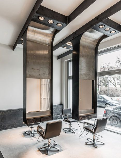 a combination of black steel and oxidised stainless steel, the suspended mirrors create a pair of two-sided styling stations in the large front room of the Viktor Leske salon.