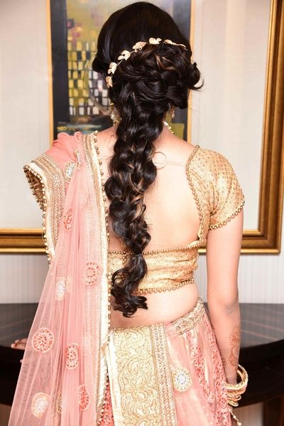 Hairstyles for Engagement - Messy Braid with Floral HeadBand   WedMeGood   Messy Long Braid for Engagement with a Pink and Gold Lehenga Beaded Detailed Lehenga  #wedmegood #indianwedding #indianbride #lehenga #pink #longbraid #hairstlyeforengagement #messybraid