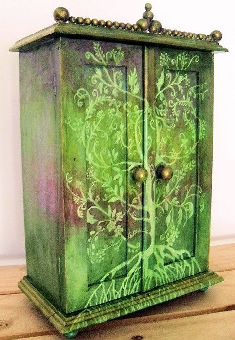 Ok, so I'm having an idea! First off, I think this cabinet/dresser/whatever is GORGEOUS. But, how perfectly nerdy and WONDERFUL would it be to recreate using black or navy background colors and either the Tree of Gondor or Gates of Moria?! We are crafty; I'm sure we could do it! The Gates of Moria would be awesome if we painted over the white/light blue lines with glow in the dark paint so it glowed at night.