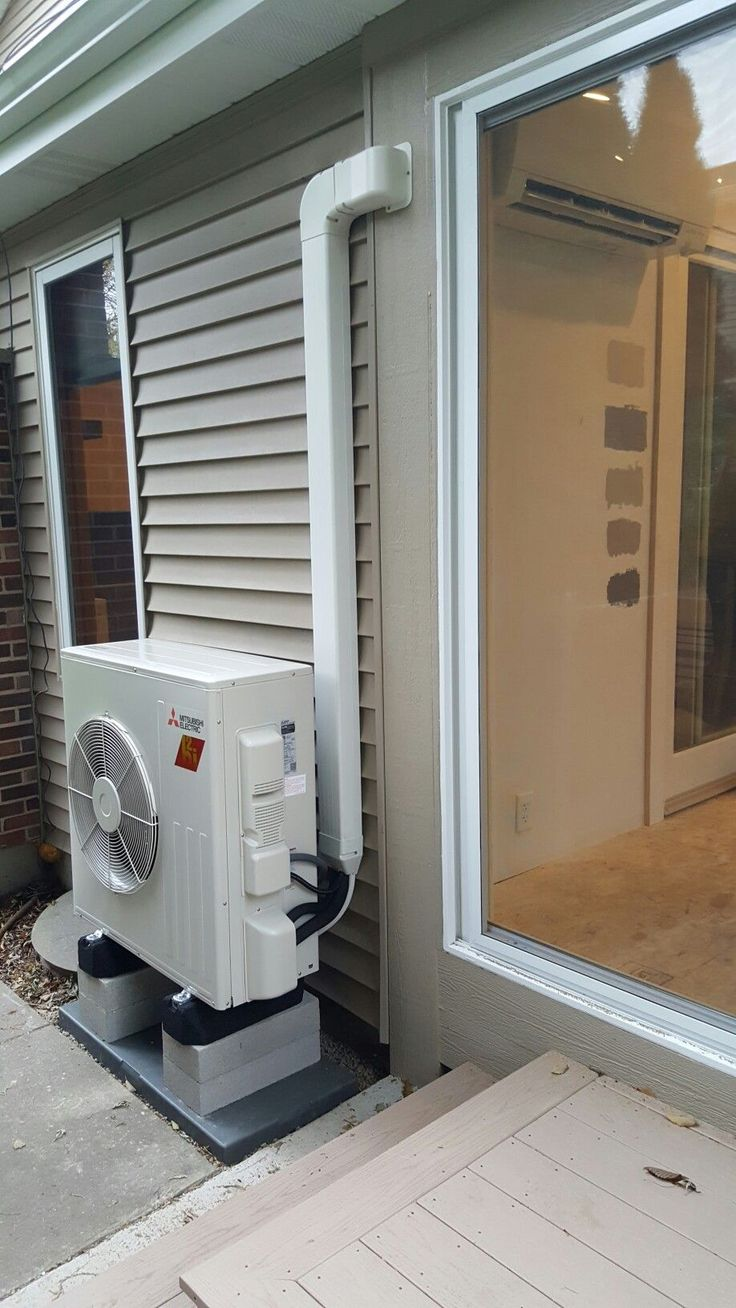 Sunroom addition being heated and cooled with a Mitsubishi Hyper-Heat ductless heat pump. Installed by Compass Heating and Air Conditioning, Inc.