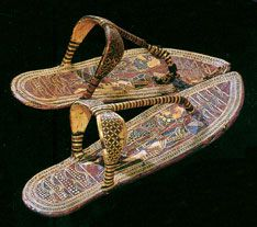 1. a) Ancient egyptian sandals made with gold. These were most likely made for the after life; since the ancient egyptians believed they could take things to the after life. The egyptians used gold in almost all aspects of their decorations and majority of the embellishments were lavish.