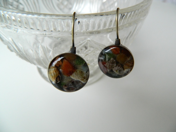 Tiny sea shells in a pair of bronze resin earrings