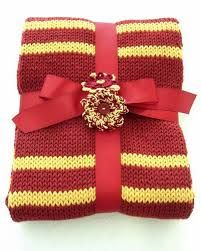 Great way to wrap gryffindor scarf- but with an actual gryffindor badge