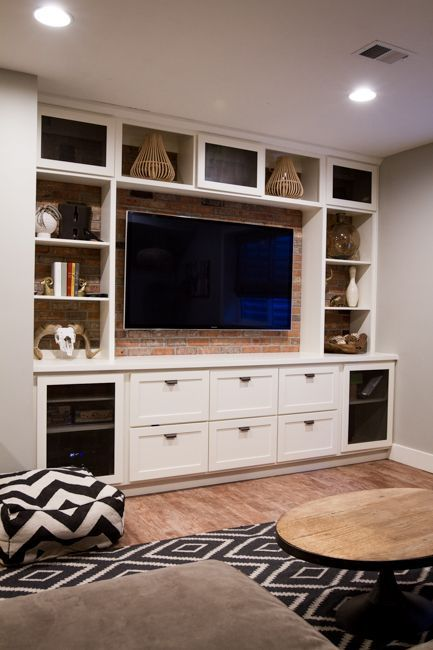 Qhite built in entertainment center with exposed brick | suburban bitches
