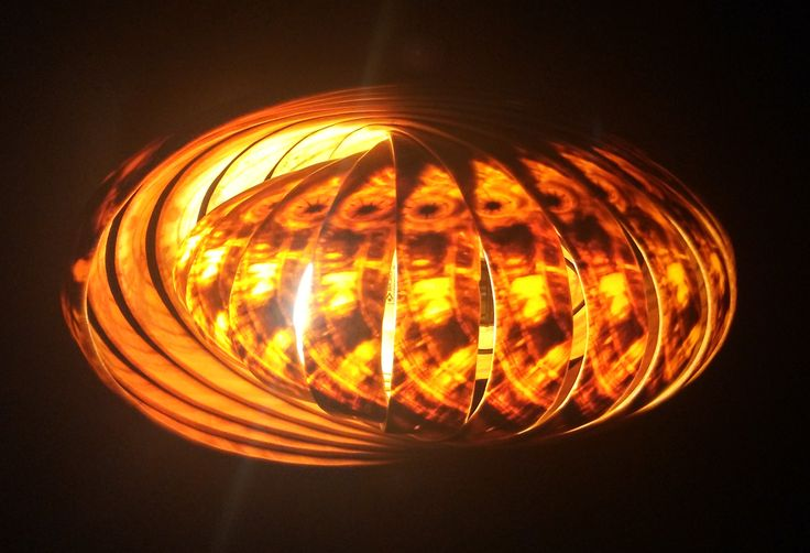 Enigmatic oval hanging lamp (Horizontal) looks intriguing because of the shell-shape with warm white light inside.