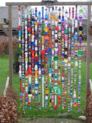made of bottle caps between the trees in the back....maybe in the school courtyard?