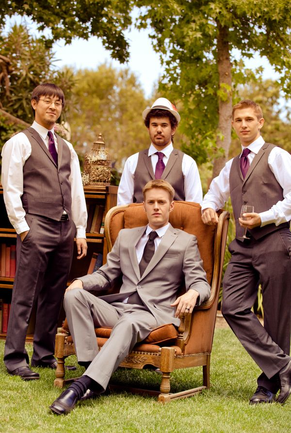 Great complementary groomsmen ensemble. Their vests and pants tone with the groom's suit, and there is a touch of rhubarb throughout.
