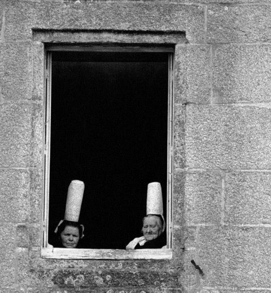 Robert Doisneau // Bigouden at the window in Brittany, France