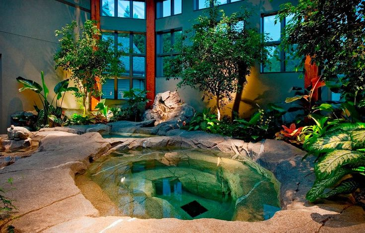 Eclectic Hot Tub with Sunken hot tub, Pond, exterior stone floors