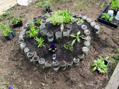 really creative garden idea using recycled glass bottles