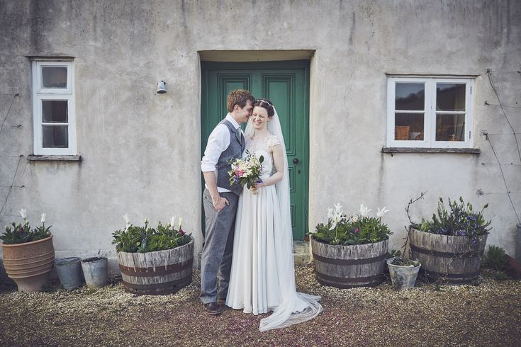 Catherine and Jim at River Cottage HQ. Love the front of the cottage for bride and groom portraits, So much texture and a warm, muted palette, perfect to offset the beautiful couple.  #rivercottagehq #rivercottage #devonwedding #foodiewedding