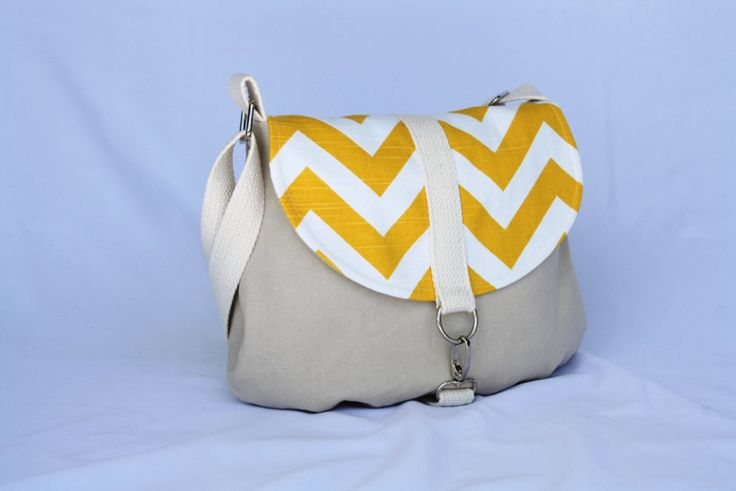 This is a super cute messenger style bag with the flap in a contrasting designer fabric - Yellow Chevron by Premier Prints. A smaller sized bag but still big enough to fit all your essentials.It can be worn as a shoulder bag or across the body if you need to be hands free. It features an adjustable strap, spring hook closure and inside pocket.