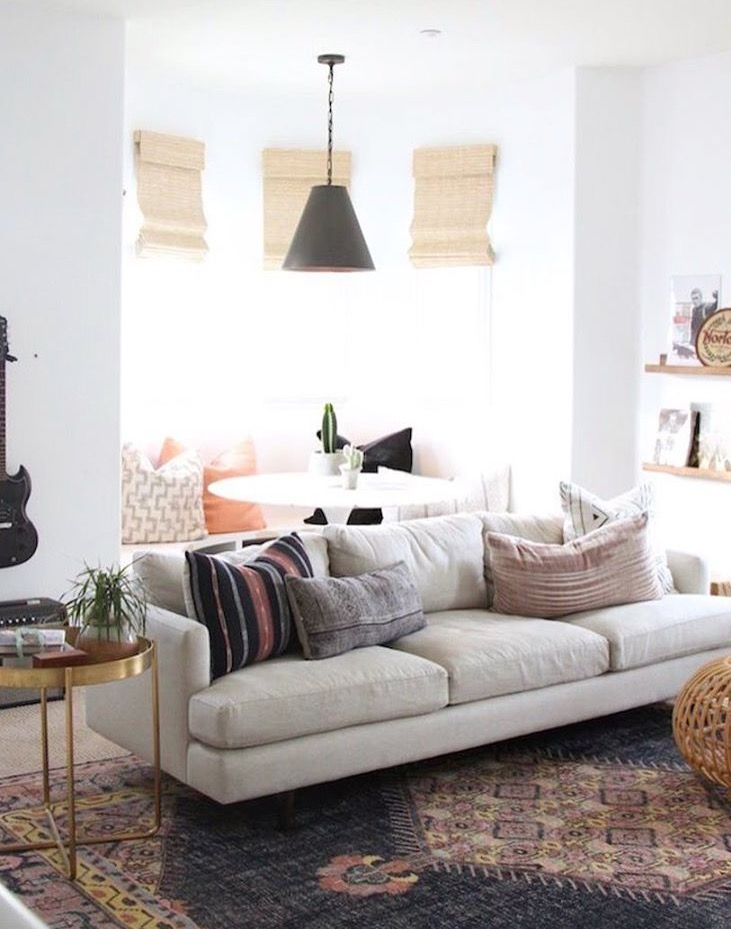 Simple, Neutral Couch + Cozy Rug And Pillows